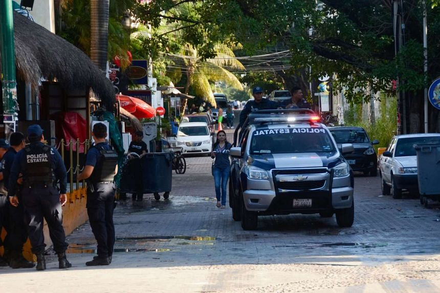 Mexican police patrol near a nightclub in Playa del Carmen, Mexico, where five people were killed during a music festival on Jan 16, 2017.