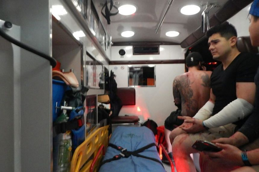 Injured receive medical treatment outside a club where a shooting took place in Playa del Carmen, Mexico.
