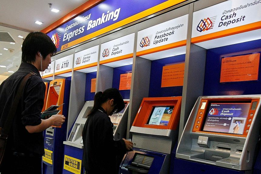 One of PromptPay's biggest draws was the planned roll-out of direct inter-bank transfers. Many Thais withdraw cash only to deposit it at another bank nearby, which is both inefficient and expensive.