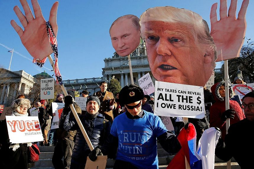 A protest against Mr Trump at the Pennsylvania State Capitol in Harrisburg, Pennsylvania, last month. Mr Trump may find he can quite easily sustain his supporters' morale by continuing to goad the very people - liberal bloggers, tweeters and Hollywoo