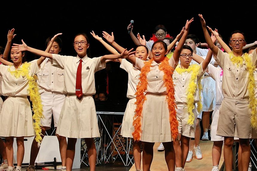 Erika (far right) managed her time well by also trying to complete her homework during rehearsal breaks. The 16-year-old (with orange streamer, right) took part in a school musical in her final year.