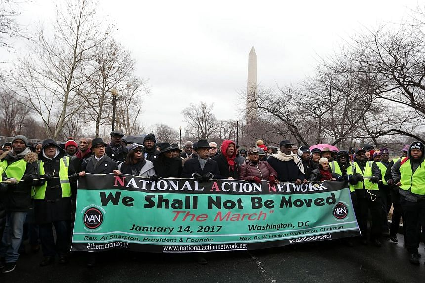 Amid a steady drizzle, thousands of demonstrators marched on Saturday from the Washington Monument to the Martin Luther King Jr Memorial in Washington, DC, seeking to bring attention to issues such as immigration, police brutality and affordable heal