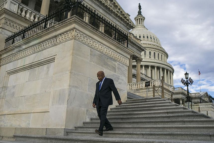 Democrat John Lewis on Capitol Hill in Washington on Friday. Many expressed indignation at Mr Trump's outburst against the civil rights icon just days before Martin Luther King Day.
