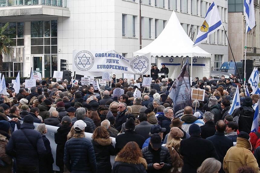 Protesters opposed to the Middle East peace conference attending a rally in Paris yesterday. The meeting comes at a critical juncture for the Middle East, five days before Mr Trump, who has sworn unstinting support for Israel, is sworn in as US presi