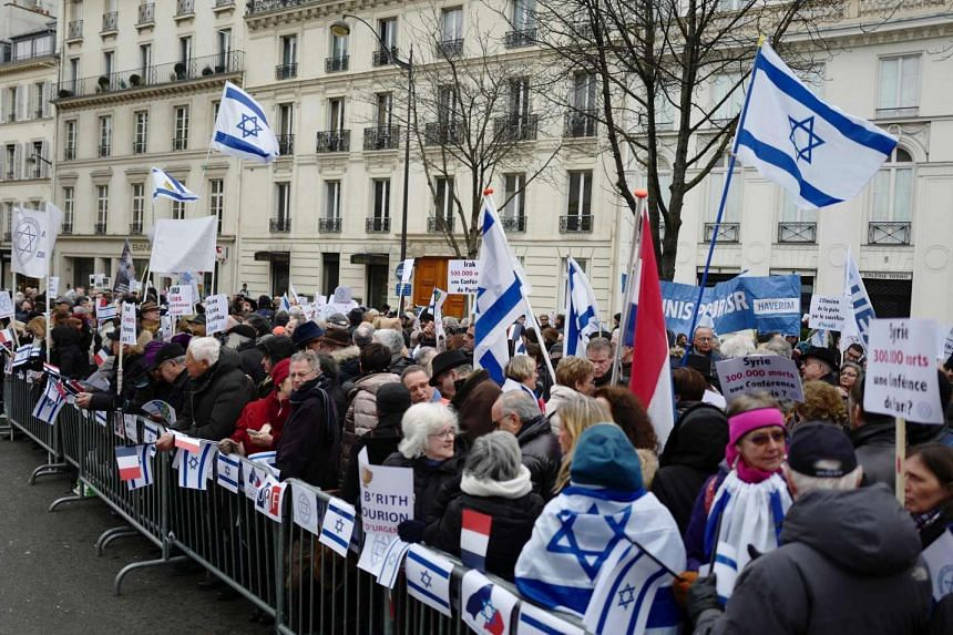 Protesters demonstrate during a rally in Paris on Sunday (Jan 15, 2017) against the Paris Middle East peace conference.