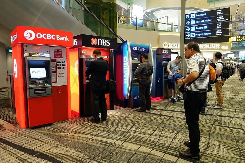 ATMs of OCBC, DBS, Citibank and UOB located at the passenger departure hall of Changi Airport Terminal 3.