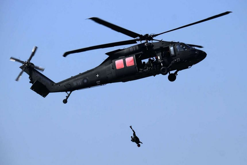 A mannnequin is thrown from a US-made Black Hawk helicopter during an annual military drill in Taichung on Jan 17, 2017.