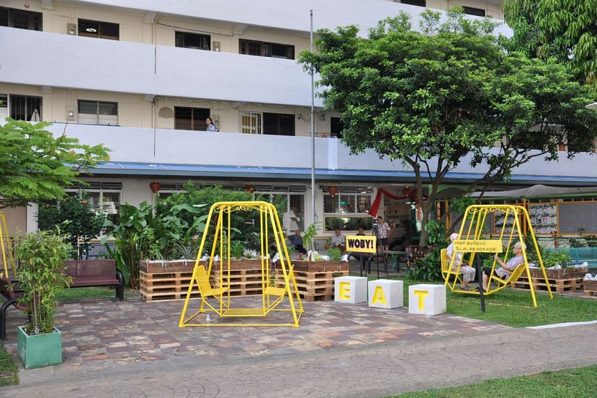 The community space between blocks 96 and 97 in Aljunied Crescent, which now features swings, gardens and areas for people to gather.