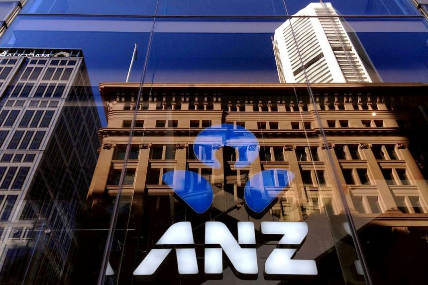 The logo of the ANZ Banking Group is displayed in the window of a newly opened branch in central Sydney.