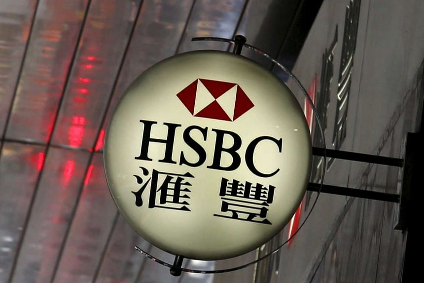 A logo of HSBC is displayed outside a branch in Hong Kong.