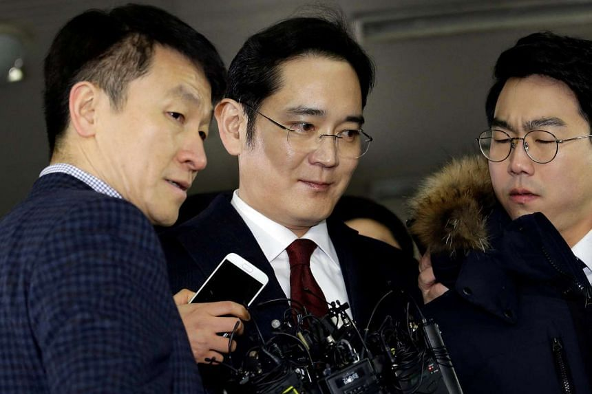 Mr Jay Y. Lee (centre) arriving to be questioned as a suspect in bribery case in the influence-peddling scandal that led to the president's impeachment at the office of the independent counsel in Seoul, South Korea, on Jan 12, 2017.