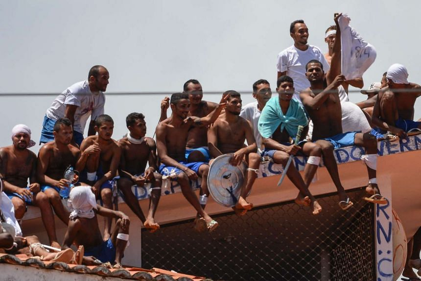 Inmates stand on the prison roof during a rebellion in Alcacuz jail in Brazil, on Jan 16, 2017.