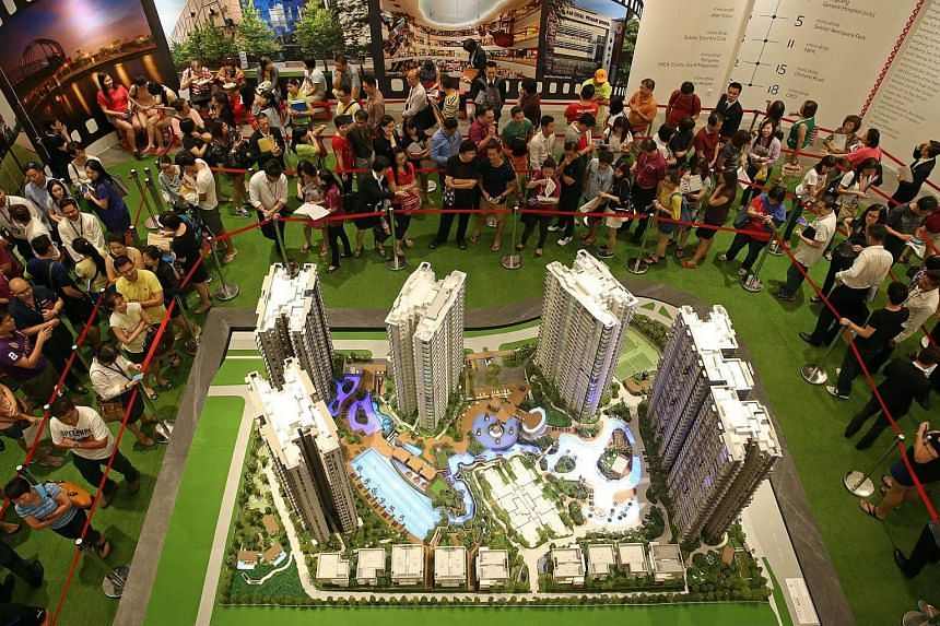 Buyers and their agents queueing to book a unit at High Park Residences, a 1,390-unit condo development in Fernvale.