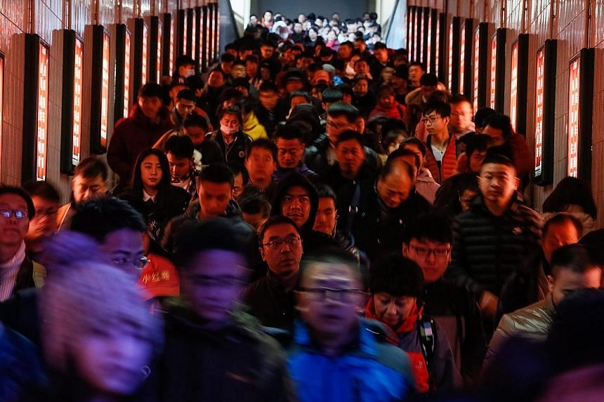 The Beijing Railway Station was packed with passengers last Friday.