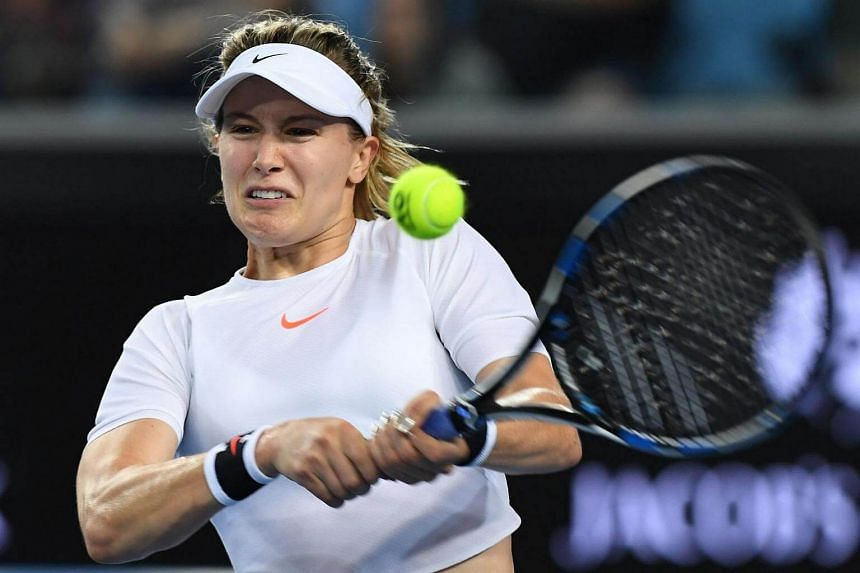 Eugenie Bouchard of Canada hits a return against Louisa Chirico of Italy during their women's singles match of the Australian Open tennis tournament in Melbourne on Jan 16, 2017.