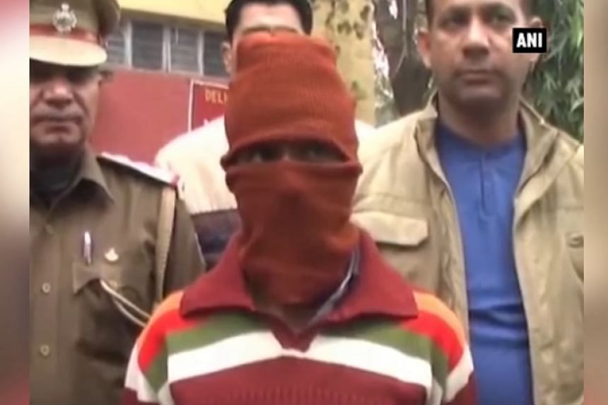 Sunil Rastogi, a 38-year-old married man with five children, is seen in a red hood in a TV news screenshot.