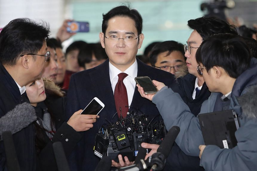Mr Lee (above) arriving at the office of the independent counsel in Seoul for questioning last Thursday. He is accused of ordering his company to give bribes to Choi, in return for government support for a 2015 merger of two major Samsung affiliates.