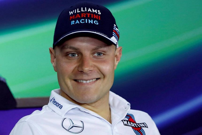 Valtteri Bottas smiles during a news conference at the Shanghai International Circuit ahead of the Chinese F1 Grand Prix.
