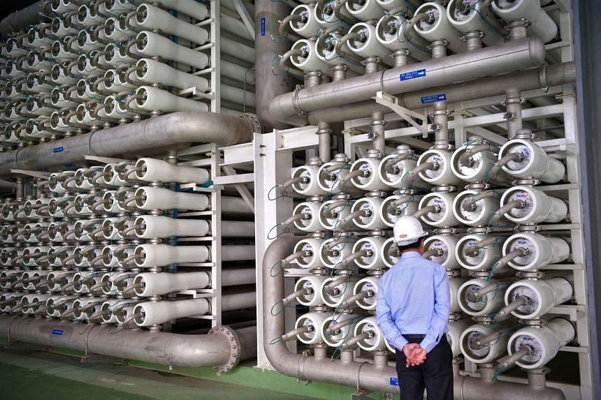 A visitor looking at the reverse osmosis systems at the new Changi Newater plant.