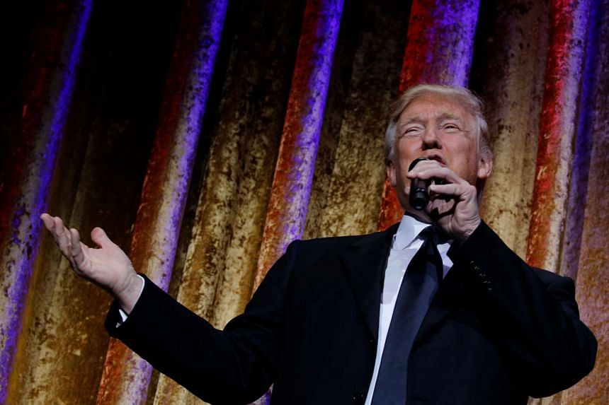 US president-elect Donald Trump speaks to diplomats at the Presidential Inaugural Committee Chairman's Global Dinner in Washington on Jan 17, 2017.