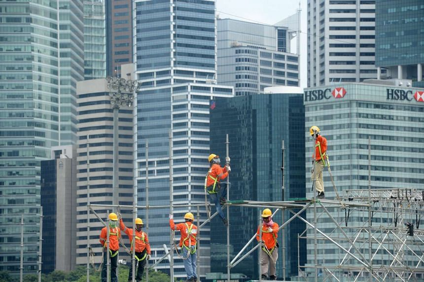 Construction workers building a scaffold near the CBD on July 14, 2015.
