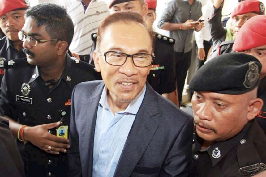 Former Malaysian opposition leader Anwar Ibrahim arriving in court on Dec 14, 2016.