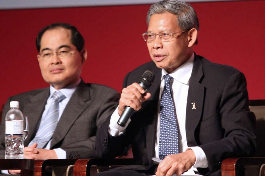Singapore's Trade and Industry Minister Lim Hng Kiang (left) with Malaysia's International Trade and Industry Minister Dato' Seri Mustapa Mohamed at the Malaysia-Singapore Business Forum held at Raffles City Convention Centre on Nov 24, 2011.