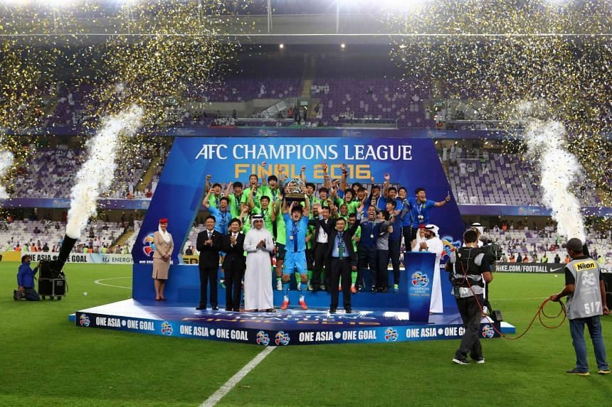 Jeonbuk players celebrate as they are crowned champions following the AFC Champions League final on Nov 26, 2016.