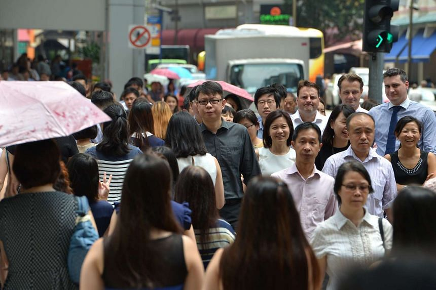 The office crowd in the Central Business District of Singapore.