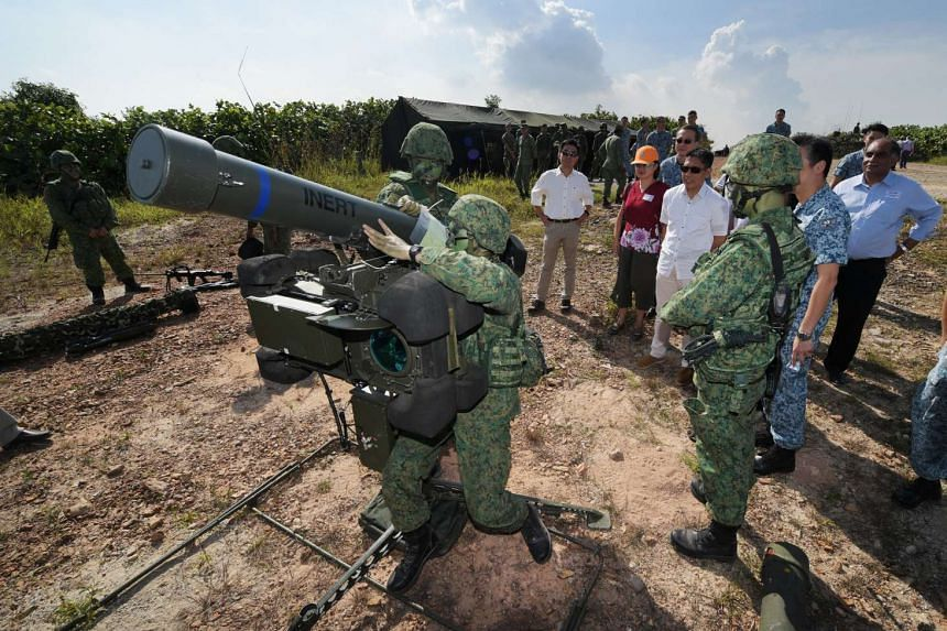 Members of a RBS-70 crew demonstrating the deployment of their missile system to Accord members and Senior Minister of State for Defence Mohamad Maliki Osman.
