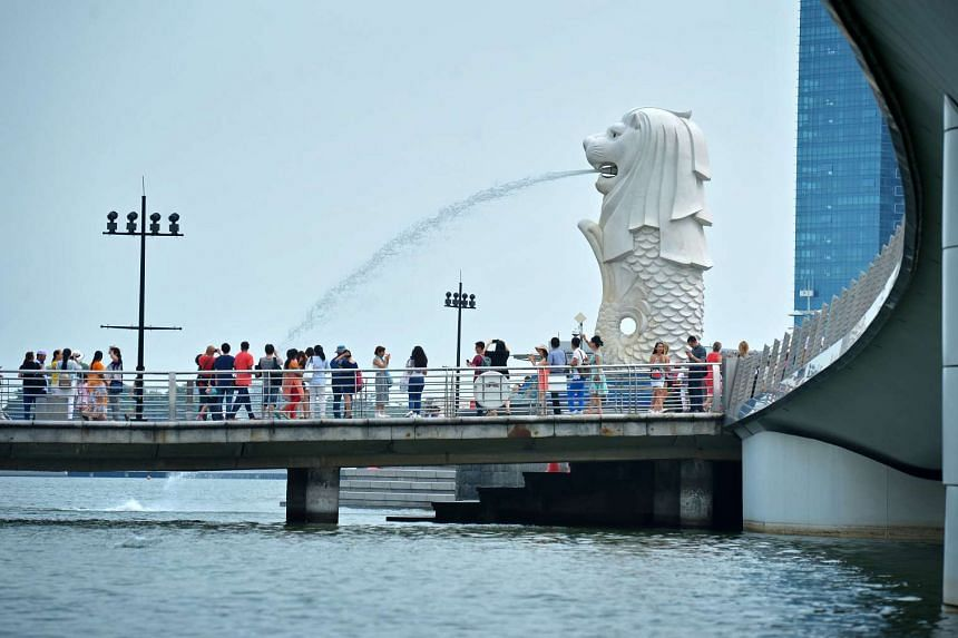 Tourists at the Merlion Park in Singapore.