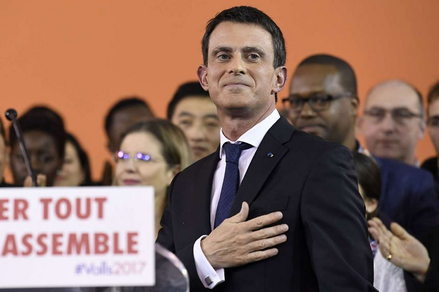 French Prime Minister Manuel Valls gestures after delivering a speech to announce his bid to become the Socialist presidential candidate in the 2017 presidential elections, at the town hall of Evry, south of Paris, on Dec 5, 2016.