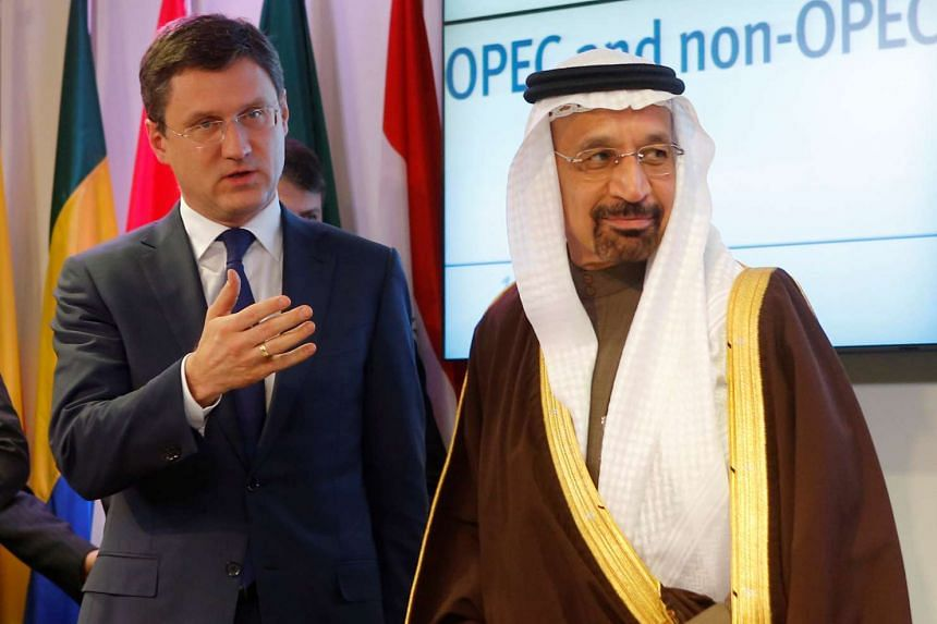 Russia's Energy Minister Alexander Novak (left) and Saudi Arabia's Energy Minister Khalid al-Falih leave a news conference after a meeting of the Organization of the Petroleum Exporting Countries (Opec) in Vienna, Austria, on Dec 10, 2016.