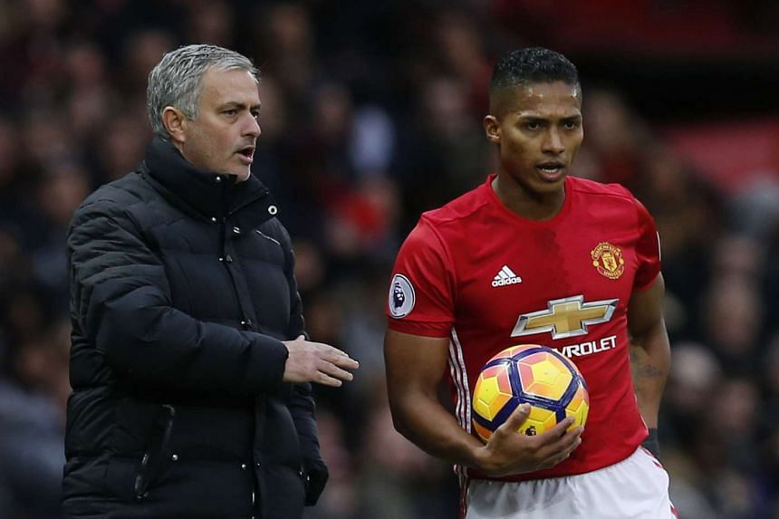 Manchester United player Antonio Valencia (right) listening to manager Jose Mourinho during their EPL match against Tottenham Hotspur on Dec 11, 2016.