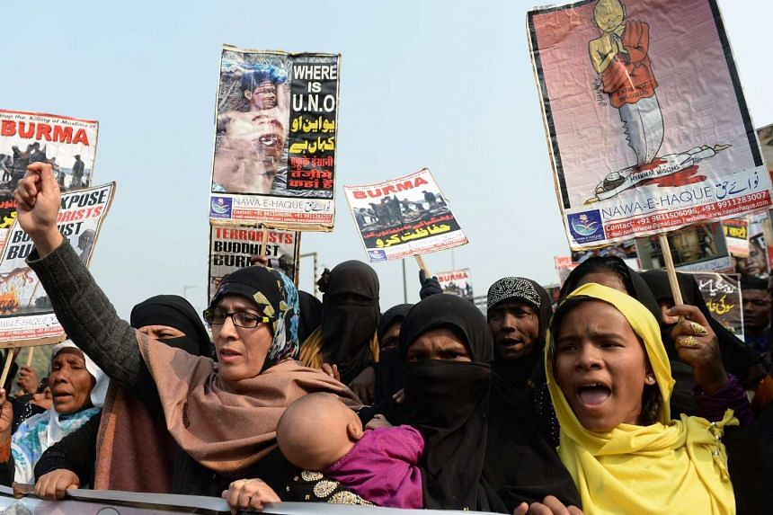 Rohingya Muslim refugees along with Indian supporters shout slogans against human rights violations in Myanmar, during a march to United Nations High Commissioner for Refugees (UNHCR) office in New Delhi on Dec 19, 2016.