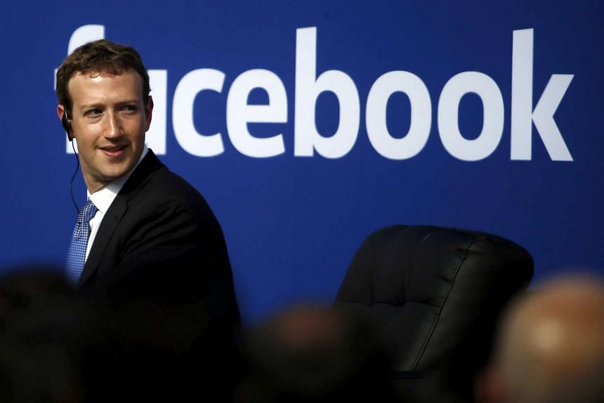 Facebook CEO Mark Zuckerberg is seen on stage during a town hall at Facebook's headquarters in Menlo Park, California on Sept 27, 2015.