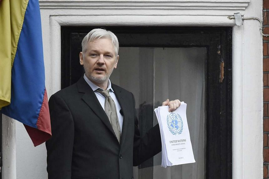 Julian Assange speaks to the media from a balcony of the Ecuadorian Embassy in London, Britain on Feb 5, 2016.