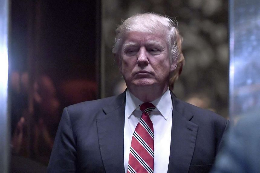 US President-elect Donald Trump standing inside the lobby elevator at Trump Tower in New York, on Jan 16, 2017.