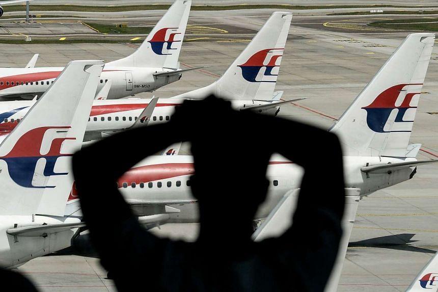 A man looking at Malaysia Airlines' aircraft parked on the tarmac at Kuala Lumpur International Airport in Sepang, on Feb 25, 2016.