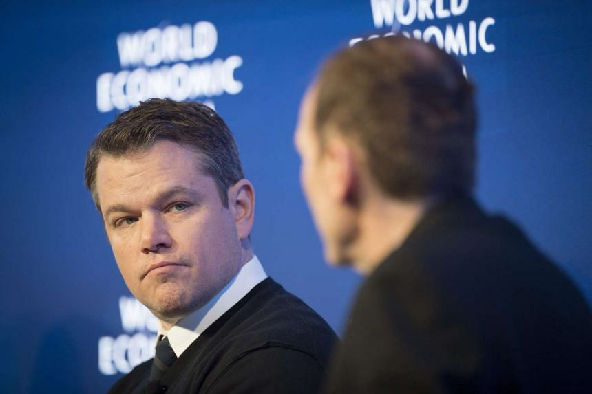 Co-Founder of Water.org Matt Damon (left) during a penal session on the first day of the 47th annual meeting of the World Economic Forum, in Davos, Switzerland, on Jan 17, 2017.