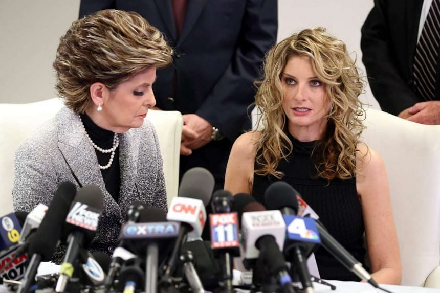 Summer Zervos (right) reads a statement as her attorney Gloria Allred looks on during a press conference with her attorney where she announced she has filed a defamation lawsuit against US President-elect Trump, in Los Angeles, California on Jan 17,