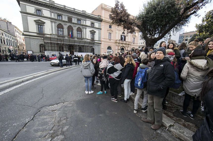Students and teachers stand outside Machiavelli school after a 5.6 magnitude earthquake struck in Rome on Jan 18, 2017.