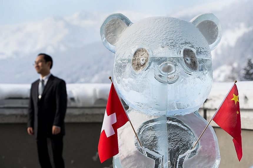 A panda ice sculpture holding the Swiss and Chinese flags, as the two countries launched a joint year of tourism on the sidelines of the World Economic Forum in Davos.