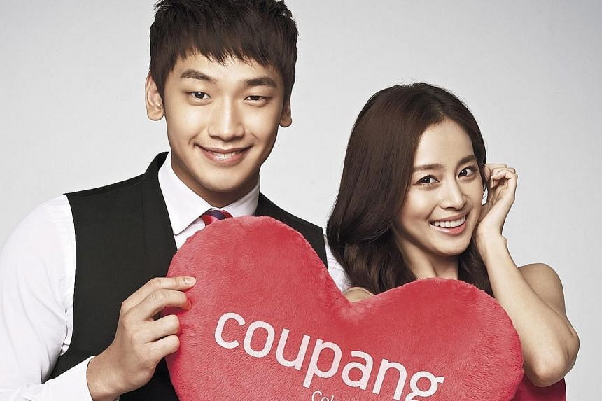 South Korean singer Rain and actress Kim Tae Hee, seen here in an advertisement, are expected to wed in a Catholic church in Seoul tomorrow.