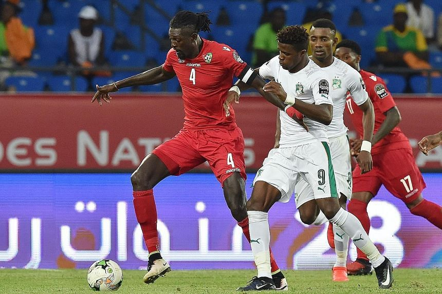 Wilfried Zaha (No. 9) could not break the deadlock as the Ivory Coast were held to a goalless stalemate by Togo.