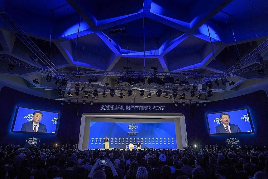 Mr Xi, the first Chinese head of state to address the annual gathering, delivering his speech at the World Economic Forum yesterday in the Swiss resort town of Davos.