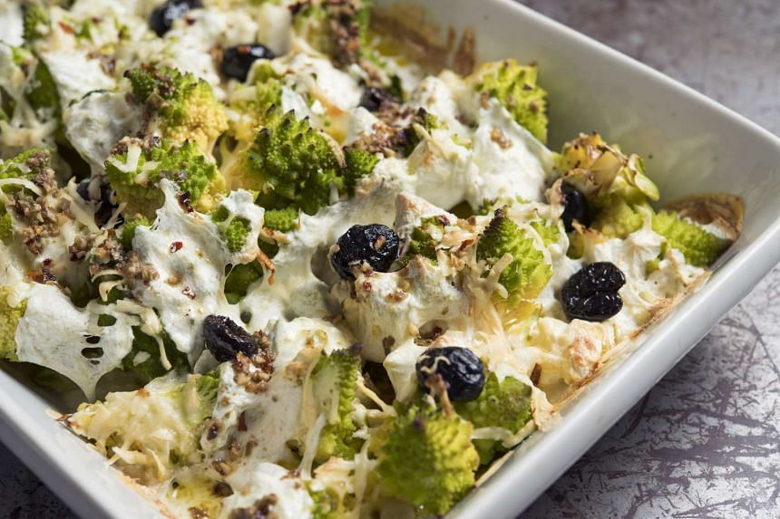 Baked romanesco broccoli with mozzarella and olives.