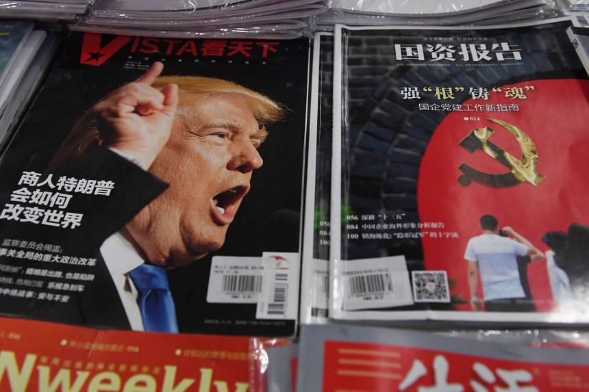 A magazine featuring US President-elect Donald Trump is seen at a bookstore in Beijing.