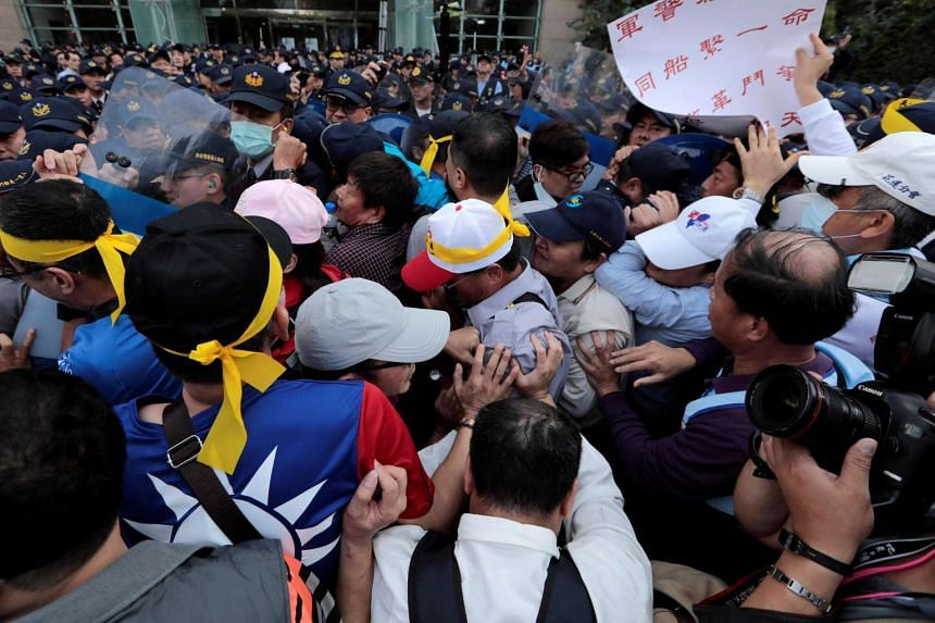 Taiwanese protesters clashing with police during a rally against an overhaul of pension funds, in Taichung on Jan 7, 2017.