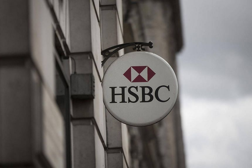A HSBC logo sits on display outside an HSBC Holdings Plc bank branch in London, UK, on June 9, 2015.